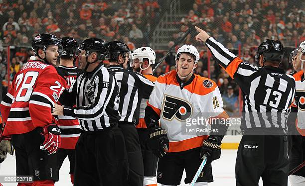 Travis Konecny of the Philadelphia Flyers scuffles with Damon Severson of the New Jersey Devils in the second period on January 21 2017 at the Wells...