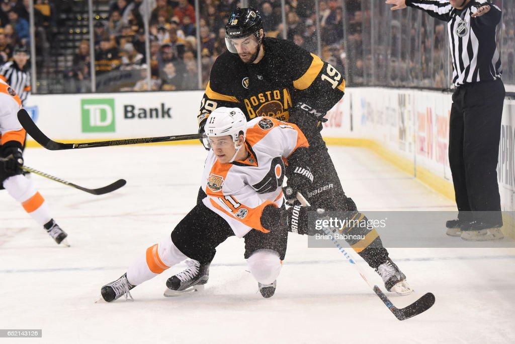 Travis Konecny #11 of the Philadelphia Flyers skates against Drew Stafford #19 of the Boston Bruins at the TD Garden on March 11, 2017 in Boston, Massachusetts.