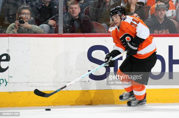 Travis Konecny of the Philadelphia Flyers skates the puck against the Carolina Hurricanes on March 19 2017 at the Wells Fargo Center in Philadelphia...