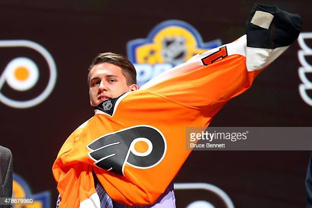 Travis Konecny poses after being selected 24th overall by the Philadelphia Flyers in the first round of the 2015 NHL Draft at BBT Center on June 26...