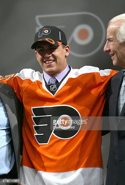 Travis Konecny poses for a photo onstage after being selected 24th overall by the Philadelphia Flyers during Round One of the 2015 NHL Draft at BBT...