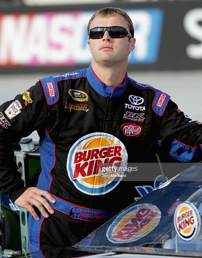 Travis Kvapil, driver of the #93 Burger King / Dr. Pepper Toyota, looks on from the grid during qualifying for the NASCAR Sprint Cup Series IRWIN Tools Night Race at Bristol Motor Speedway on August 23, 2013 in Bristol, Tennessee.