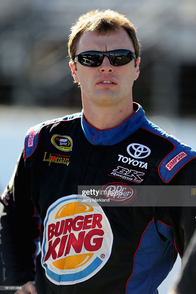 Travis Kvapil, driver of the #93 Burger King / Dr. Pepper Toyota, looks on from the grid during qualifying for the NASCAR Sprint Cup Series Sylvania 300 at New Hampshire Motor Speedway on September 20, 2013 in Loudon, New Hampshire.