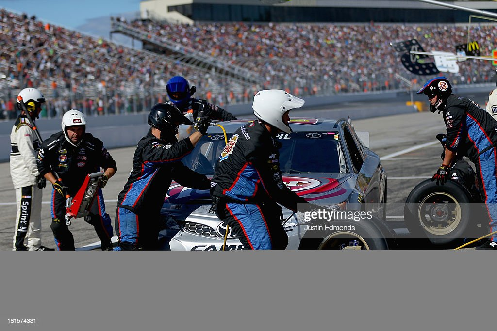 Travis Kvapil, driver of the #93 Burger King / Dr. Pepper Toyota, pits during the NASCAR Sprint Cup Series Sylvania 300 at New Hampshire Motor Speedway on September 22, 2013 in Loudon, New Hampshire.