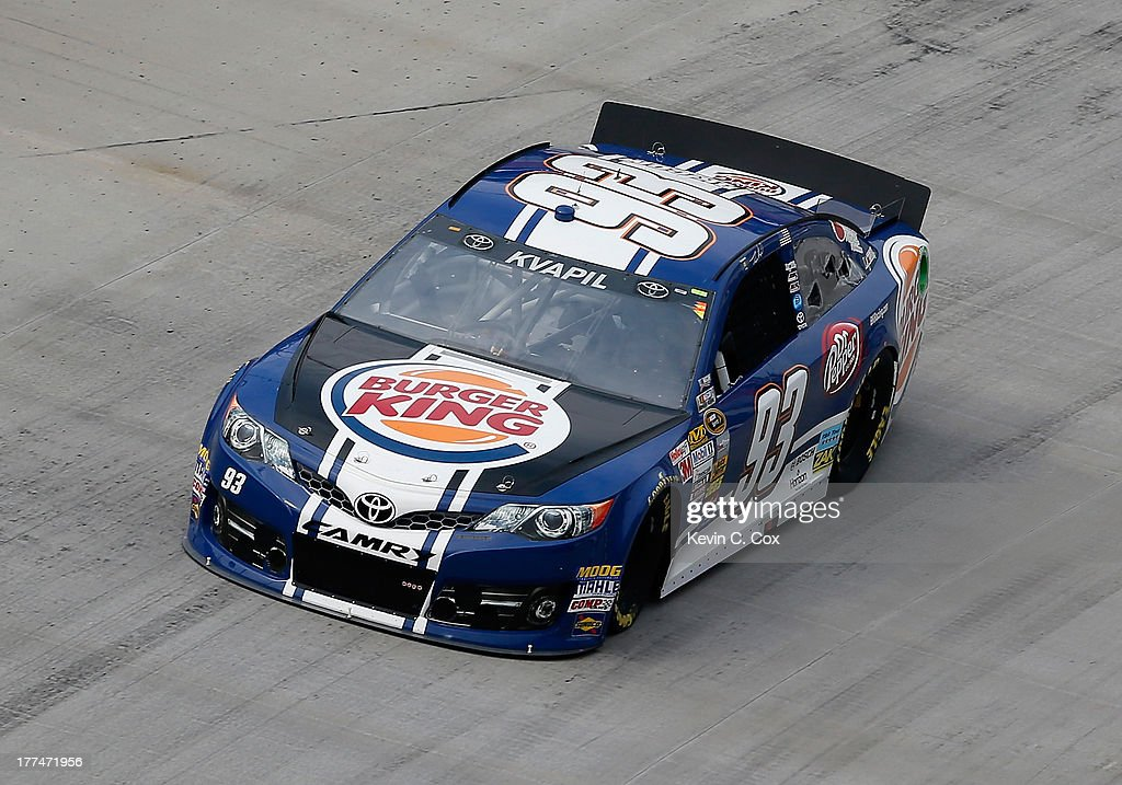 Travis Kvapil, driver of the #93 Burger King / Dr. Pepper Toyota, practices for the NASCAR Sprint Cup Series IRWIN Tools Night Race at Bristol Motor Speedway on August 23, 2013 in Bristol, Tennessee.
