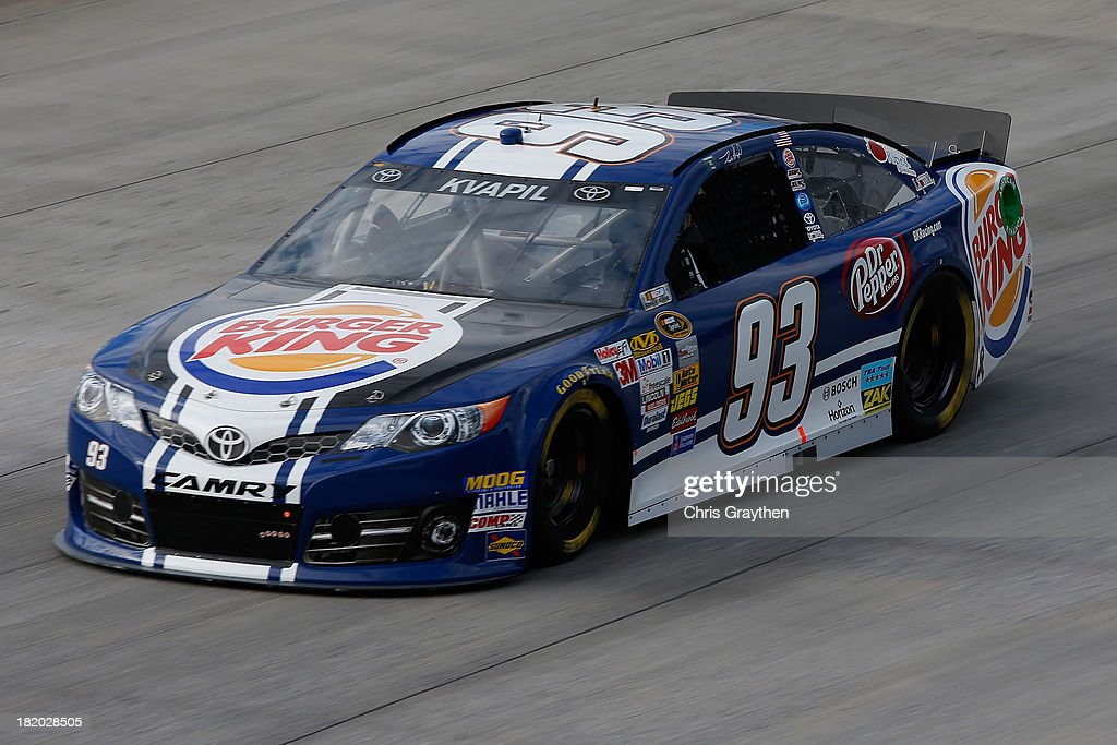 Travis Kvapil, driver of the #93 Burger King / Dr. Pepper Toyota, practices for the NASCAR Sprint Cup Series AAA 400 at Dover International Speedway on September 27, 2013 in Dover, Delaware.