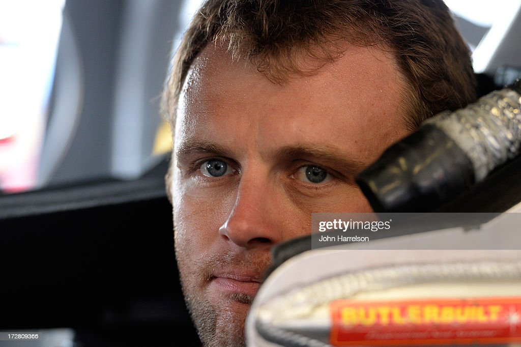 Travis Kvapil, driver of the #93 Burger King / Dr. Pepper Toyota, sits in his car during practice for the NASCAR Sprint Cup Series Coke Zero 400 at Daytona International Speedway on July 4, 2013 in Daytona Beach, Florida.