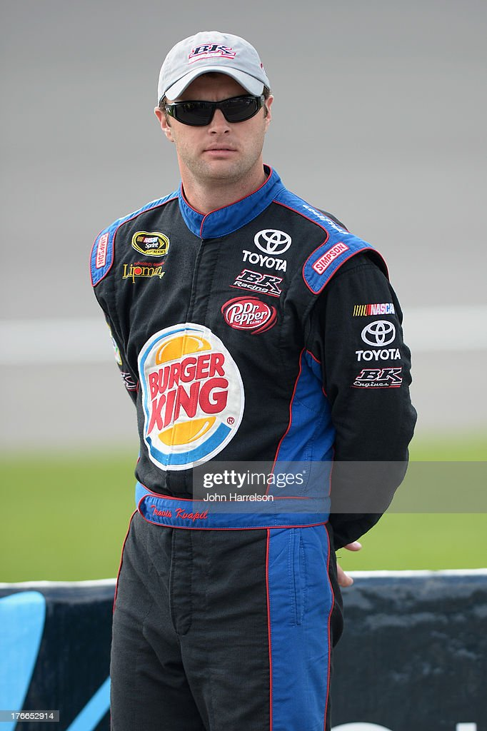 Travis Kvapil, driver of the #93 Burger King / Dr. Pepper Toyota, stands on the grid during qualifying for the NASCAR Sprint Cup Series 44th Annual Pure Michigan 400 at Michigan International Speedway on August 16, 2013 in Brooklyn, Michigan.
