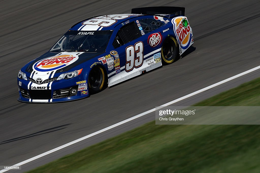 Travis Kvapil, driver of the #93 Burger King/Dr. Pepper Toyota, during testing for the NASCAR Sprint Cup Series at Kansas Speedway on October 3, 2013 in Kansas City, Kansas.