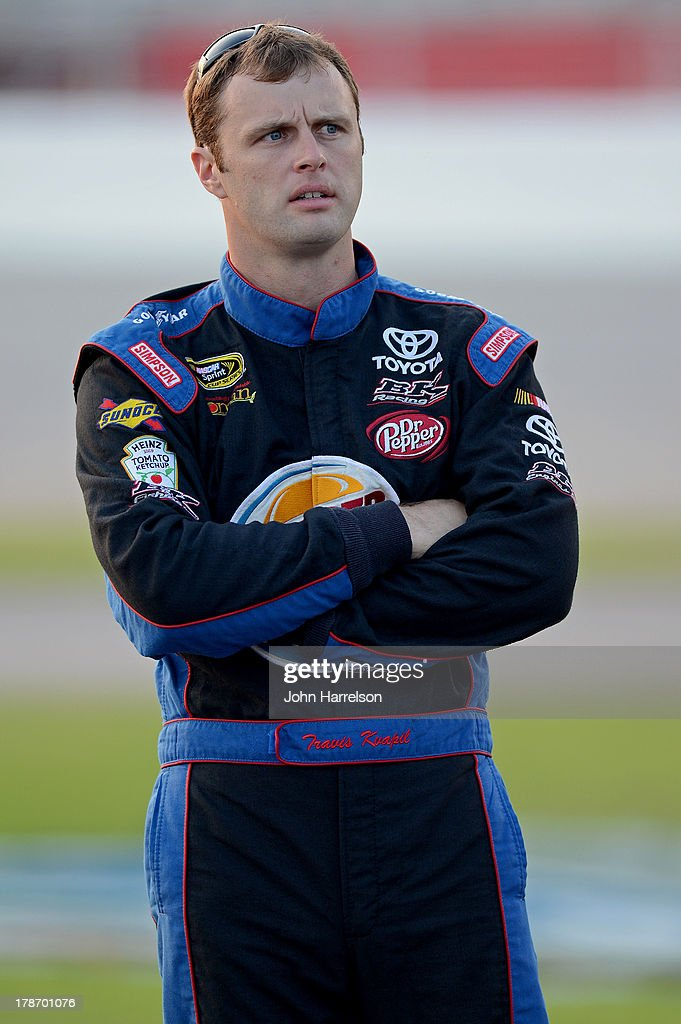 Travis Kvapil, driver of the #93 Burger King/Dr. Pepper Toyota, looks on during qualifying for the NASCAR Sprint Cup Series AdvoCare 500 at Atlanta Motor Speedway on August 30, 2013 in Hampton, Georgia.