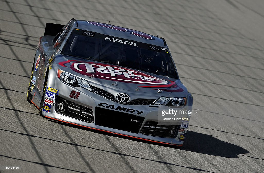 Travis Kvapil, driver of the #93 Burger King/Dr. Pepper Toyota, practices for the NASCAR Sprint Cup Series Geico 400 at Chicagoland Speedway on September 13, 2013 in Joliet, Illinois.