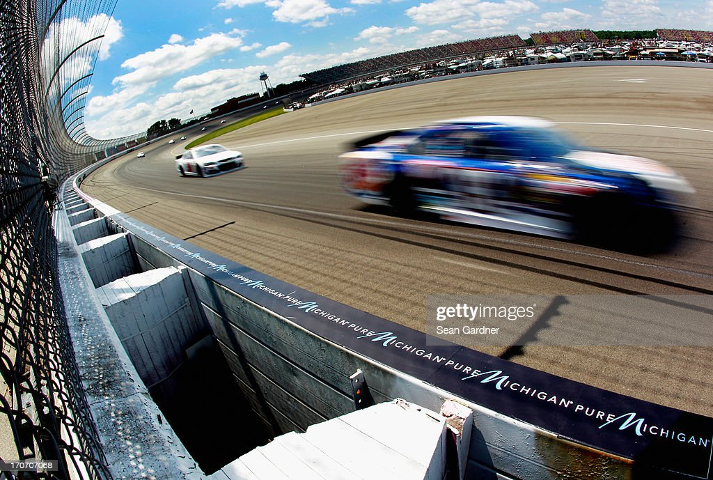 Travis Kvapil, driver of the #93 Burger King/Dr. Pepper Toyota, races during the NASCAR Sprint Cup Series Quicken Loans 400 at Michigan International Speedway on June 16, 2013 in Brooklyn, Michigan.