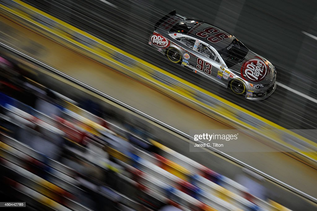 <a gi-track='captionPersonalityLinkClicked' href=/galleries/search?phrase=Travis+Kvapil&family=editorial&specificpeople=239027 ng-click='$event.stopPropagation()'>Travis Kvapil</a>, driver of the #93 Dr. Pepper Toyota, during the NASCAR Sprint Cup Series Bank of America 500 at Charlotte Motor Speedway on October 12, 2013 in Concord, North Carolina.