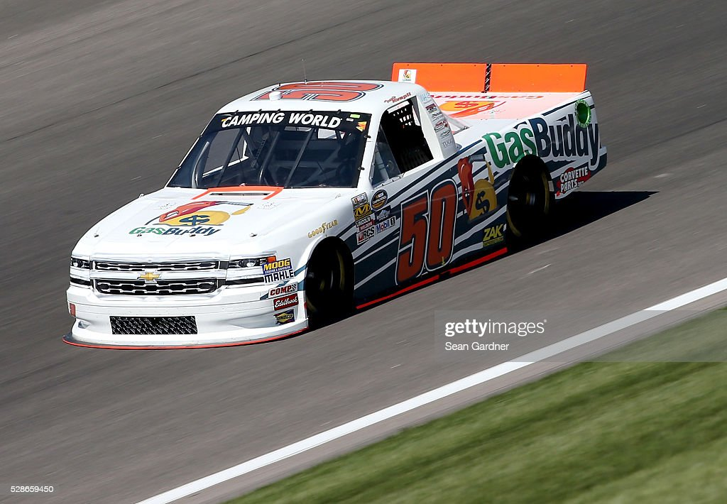 Travis Kvapil, driver of the (50) Gas Buddy Chevrolet, drives during qualifying for the NASCAR Camping World Truck Series Toyota Tundra 250 at Kansas Speedway on May 6, 2016 in Kansas City, Kansas.
