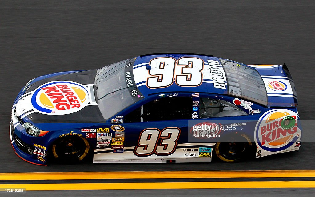 Travis Kvapil drives the #93 Burger King / Dr. Pepper Toyota during practice for the NASCAR Sprint Cup Series Coke Zero 400 at Daytona International Speedway on July 4, 2013 in Daytona Beach, Florida.