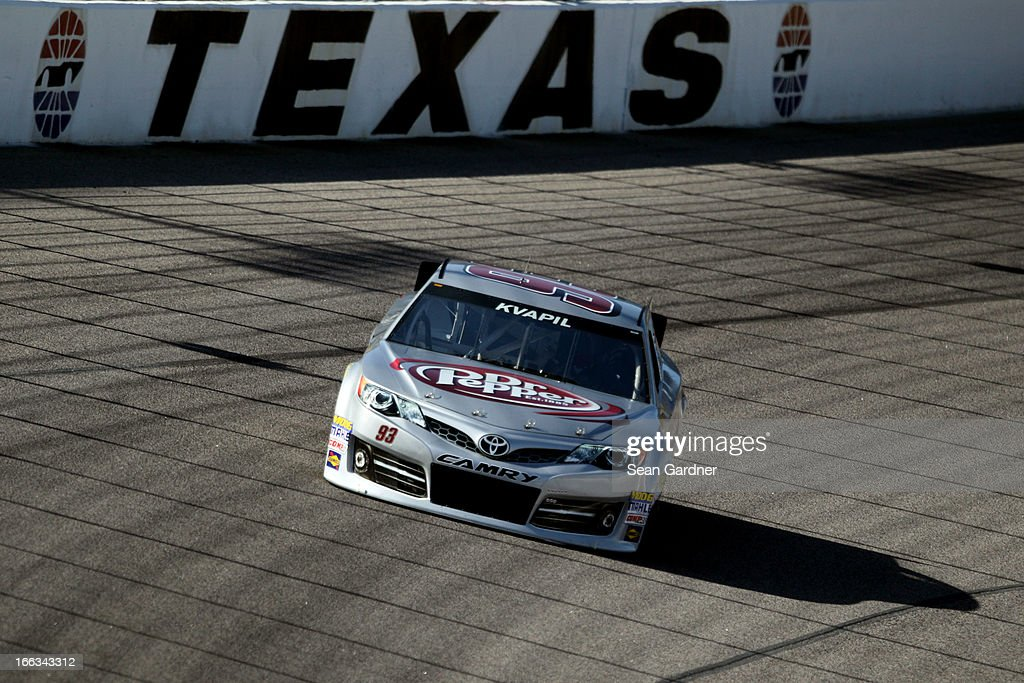 Travis Kvapil drives the #93 Burger King/Dr. Pepper Toyota during NASCAR Sprint Cup Series Gen-6 Testing at Texas Motor Speedway on April 11, 2013 in Fort Worth, Texas.