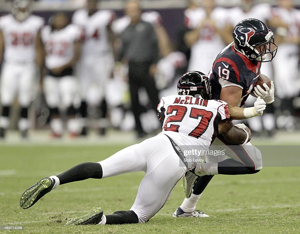 Travis Labhart #19 of the Houston Texans is tackled by Robert McClain #27 of the Atlanta Falcons in the third quarter in a pre-season NFL game on August 16, 2014 at NRG Stadium in Houston, Texas.