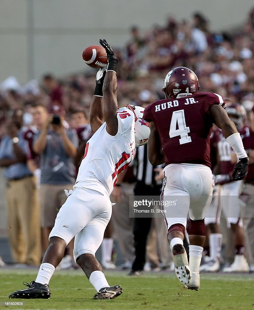 Travis Labhart #15 of the Texas A&M Aggies makes a catch while Toney Hurd Jr. #4 of the Texas A&M Aggies covers in the second half on September 21, 2013 at Kyle Field in College Station, Texas.