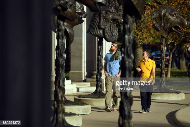 Travis Leeatherman and Gabriel Hershberger check out the Zodiak sculptures at Civic Center Park The Denver Arts Venues celebrates the arrival of Ai...