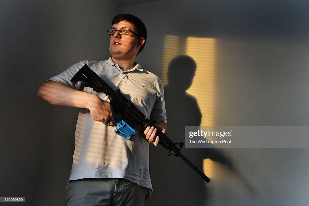 Travis Lerol holds an AR-15 assault rifle that contains a bullet clip made of ABS (Acrylonitrile Butadiene Styrene) plastic that was constructed by his 3D printer at his home on Tuesday, February 12, 2012, in Glen Burnie, MD. Lerol is a techie and gun owner who has tried using a 3-D printing program that makes parts for the AR-15 style assault rifle.