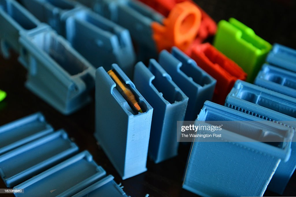 Travis Lerol makes gun parts as well as trinkets like chess pieces out of ABS (Acrylonitrile Butadiene Styrene) plastic constructed by his 3D printer at his home on Tuesday, February 12, 2012, in Glen Burnie, MD. Lerol is a techie and gun owner who has tried using a 3-D printing program that makes parts for the AR-15 style assault rifle.