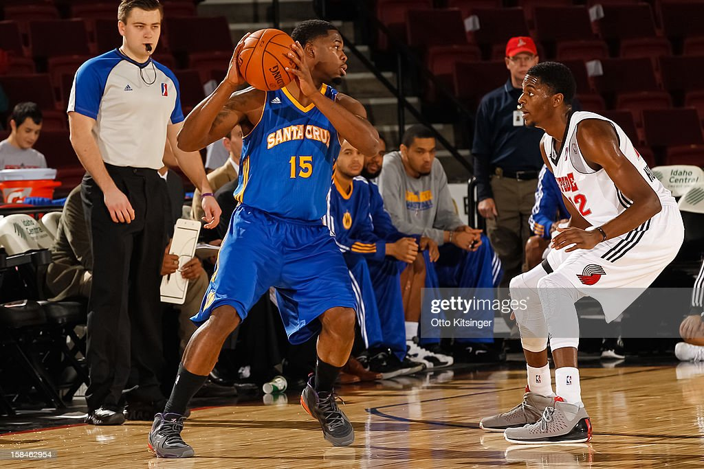 <a gi-track='captionPersonalityLinkClicked' href=/galleries/search?phrase=Travis+Leslie&family=editorial&specificpeople=6580397 ng-click='$event.stopPropagation()'>Travis Leslie</a> #15 of the Santa Cruz Warriors looks for a pass around Justin Holiday #12 of the Idaho Stampede on December 15, 2012 at CenturyLink Arena in Boise, Idaho.