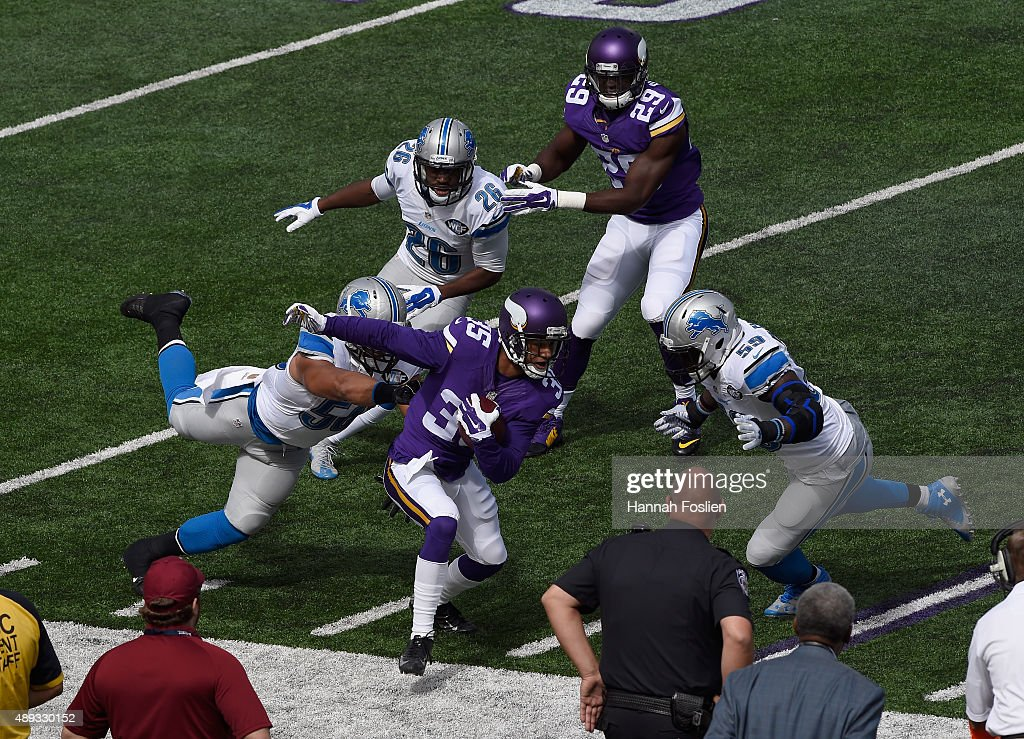 Travis Lewis of the Detroit Lions pushes Marcus Sherels of the Minnesota Vikings out of bounds on a punt return during the first quarter of the game...