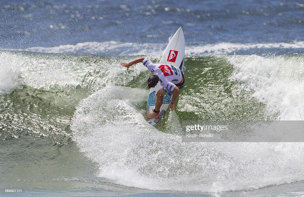 Travis Logie of South Africa surfs during round four of the Quiksilver Pro on March 11, 2013 in Gold Coast, Australia.