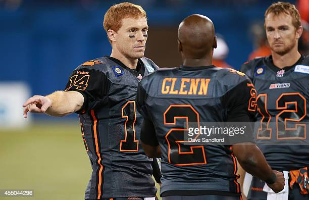 Travis Lulay Kevin Glenn and John Beck all of the BC Lions talk together as they face the Toronto Argonauts during their game at Rogers Centre on...