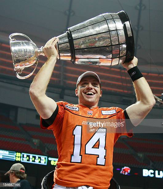 Travis Lulay of the BC Lions holds up the Grey Cup during the CFL 99th Grey Cup against the Winnipeg Blue Bombers November 27 2011 at BC Place in...