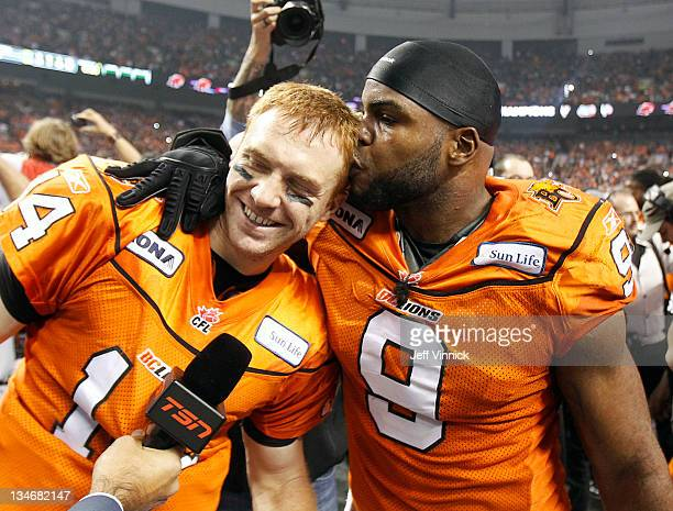 Travis Lulay of the BC Lions is kissed by teammate Keron Williams after winning the CFL 99th Grey Cup against the Winnipeg Blue Bombers November 27...