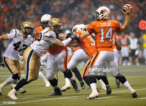 Travis Lulay of the BC Lions looks for an open teammate to throw the ball to during the game against the Winnipeg Blue Bombers during the Grey Cup at...