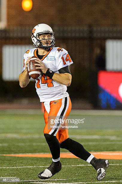 Travis Lulay of the BC Lions looks to play the ball during the CFL game against the Montreal Alouettes at Percival Molson Stadium on September 3 2015...