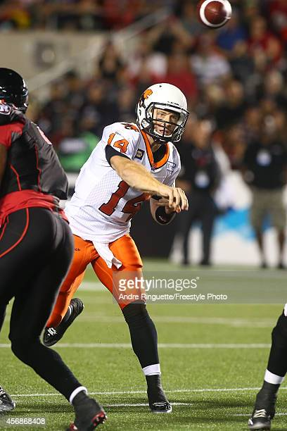 Travis Lulay of the BC Lions passes the ball against the Ottawa Redblacks during a CFL game at TD Place Stadium on September 5 2014 in Ottawa Ontario...