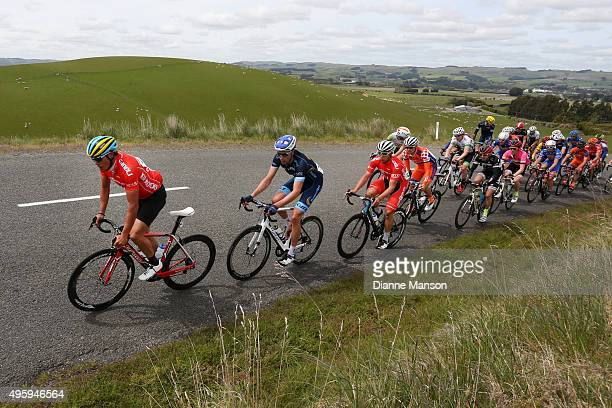 Travis McCabe of US leads the main peloton towards Gore during stage five of the Tour of Southland on November 6 2015 in Invercargill New Zealand