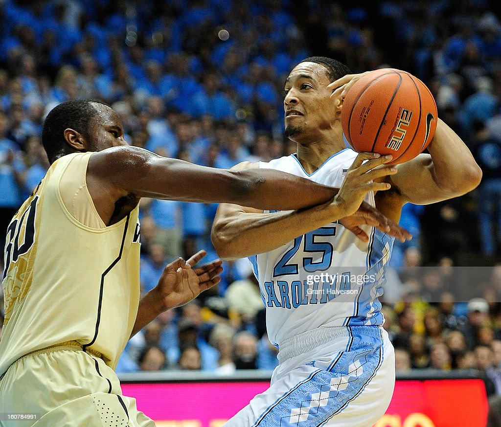 Travis McKie #30 of the Wake Forest Demon Deacons fouls J.P. Tokoto #25 of the North Carolina Tar Heels during play at the Dean Smith Center on February 5, 2013 in Chapel Hill, North Carolina. North Carolina won 87-62.
