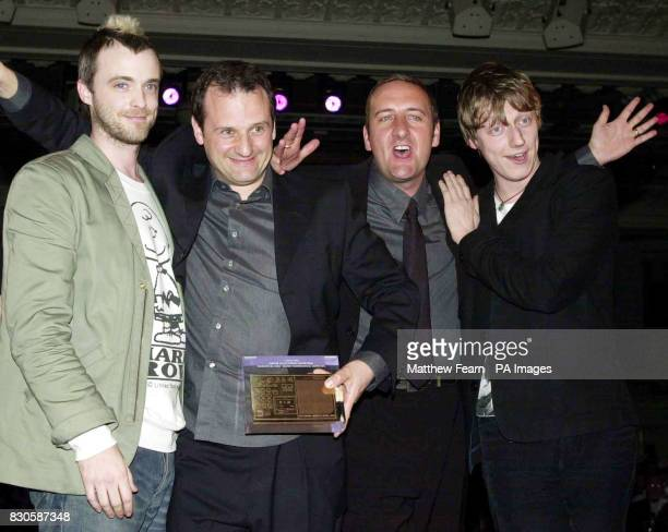 Travis members Fran Healey and Dougie Payne present Mark Radcliffe and Marc 'Lard' Riley with the Music Programming Award during the Sony Radio...