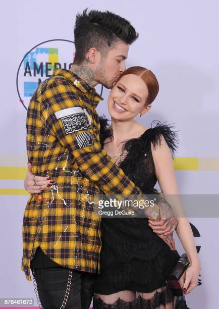 Travis Mills and Madelaine Petsch arrive at the 2017 American Music Awards at Microsoft Theater on November 19 2017 in Los Angeles California