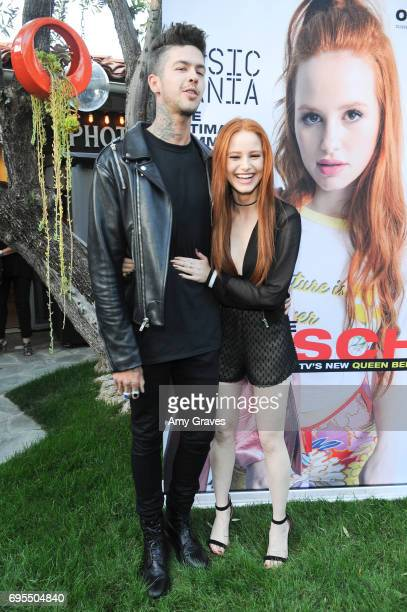 Travis Mills and Madelaine Petsch attends the Popular X Wildfox Cover Launch Event For Madelaine Petsch in Los Angeles on June 12 2017 in Los Angeles...