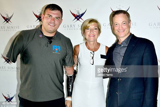 Travis Mills Executive Director of the Gary Sinise Foundation Judy Otter and actor Gary Sinise attend 'Travis A Soldier's Story' benefit screening at...