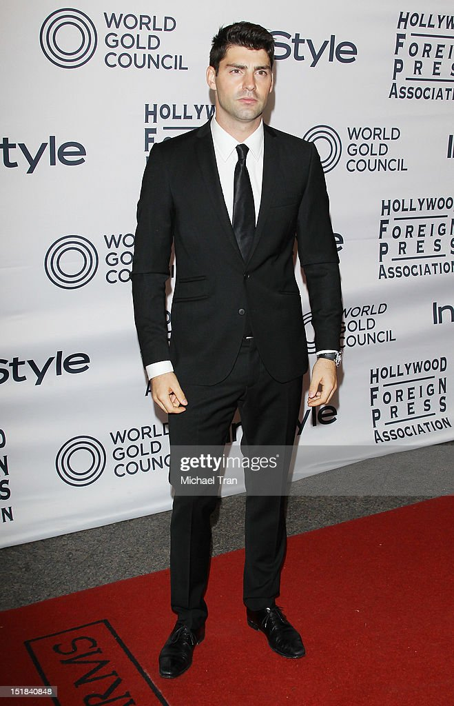 Travis Milne arrives at the Instyle and the Hollywood Foreign Press Association Party during the 2012 Toronto International Film Festival held at Windsor Arms Hotel on September 11, 2012 in Toronto, Canada.