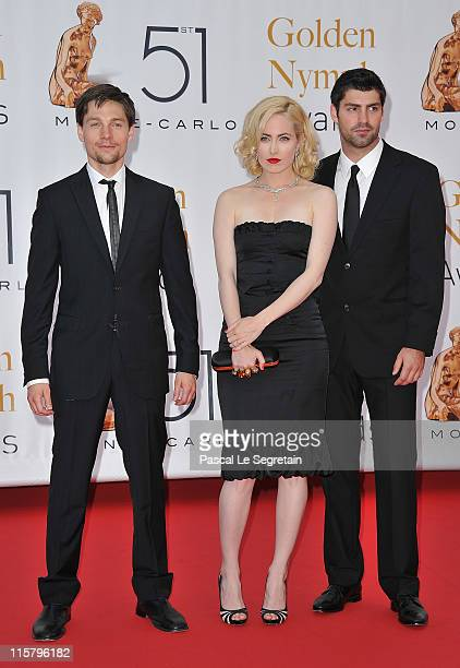 Travis Milne Charlotte Sullivan and Gregory Smith arrive at the closing ceremony of the 51st Monte Carlo TV Festival at the Grimaldi forum on June 10...
