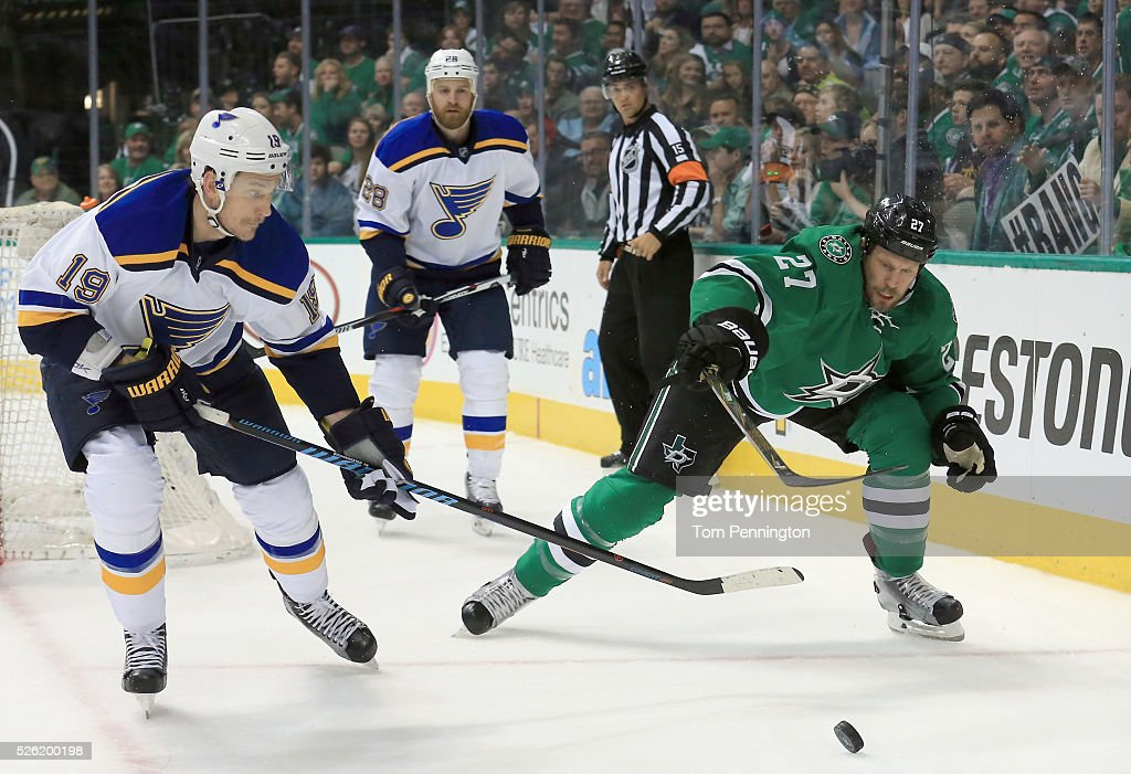 <a gi-track='captionPersonalityLinkClicked' href=/galleries/search?phrase=Travis+Moen&family=editorial&specificpeople=208110 ng-click='$event.stopPropagation()'>Travis Moen</a> #27 of the Dallas Stars controls the puck against <a gi-track='captionPersonalityLinkClicked' href=/galleries/search?phrase=Jay+Bouwmeester&family=editorial&specificpeople=201875 ng-click='$event.stopPropagation()'>Jay Bouwmeester</a> #19 of the St. Louis Blues in the first period in Game One of the Western Conference Second Round during the 2016 NHL Stanley Cup Playoffs at American Airlines Center on April 29, 2016 in Dallas, Texas.