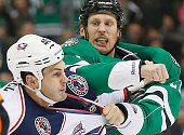 Travis Moen of the Dallas Stars takes a swing at Jared Boll of the Columbus Blue Jackets in the second period at American Airlines Center on January...
