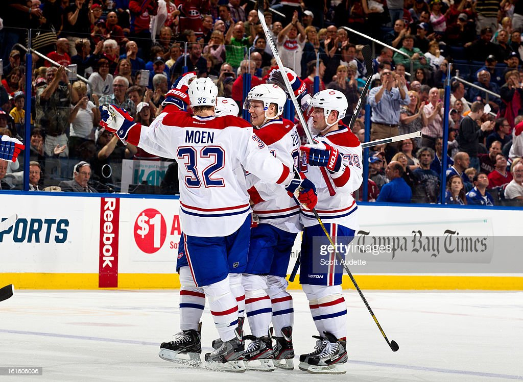 <a gi-track='captionPersonalityLinkClicked' href=/galleries/search?phrase=Travis+Moen&family=editorial&specificpeople=208110 ng-click='$event.stopPropagation()'>Travis Moen</a> #32 of the Montreal Canadiens celebrates with his teammates after a goal during the second period of the game against the Tampa Bay Lightning at the Tampa Bay Times Forum on February 12, 2013 in Tampa, Florida.