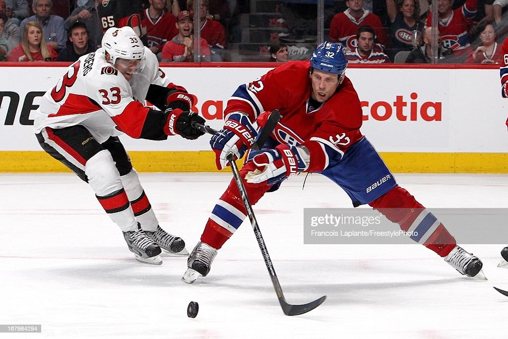 <a gi-track='captionPersonalityLinkClicked' href=/galleries/search?phrase=Travis+Moen&family=editorial&specificpeople=208110 ng-click='$event.stopPropagation()'>Travis Moen</a> #32 of the Montreal Canadiens controls the puck against <a gi-track='captionPersonalityLinkClicked' href=/galleries/search?phrase=Jakob+Silfverberg&family=editorial&specificpeople=5894639 ng-click='$event.stopPropagation()'>Jakob Silfverberg</a> #33 of the Ottawa Senators in Game Two of the Eastern Conference Quarterfinals during the 2013 NHL Stanley Cup Playoffs at the Bell Centre on May 3, 2013 in Montreal, Quebec, Canada.