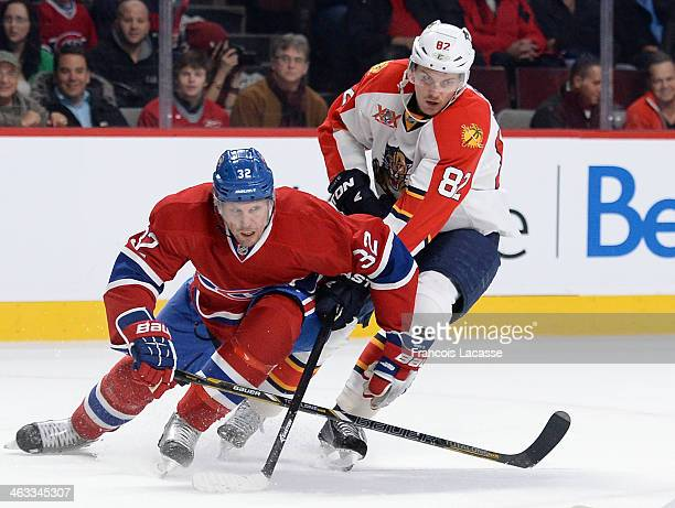 Travis Moen of the Montreal Canadiens fights for the puck against Tomas Kopecky of the Florida Panthers during the NHL game on January 6 2014 at the...