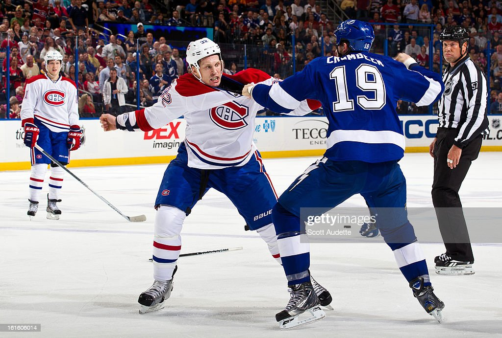 <a gi-track='captionPersonalityLinkClicked' href=/galleries/search?phrase=Travis+Moen&family=editorial&specificpeople=208110 ng-click='$event.stopPropagation()'>Travis Moen</a> #32 of the Montreal Canadiens fights with <a gi-track='captionPersonalityLinkClicked' href=/galleries/search?phrase=B.J.+Crombeen&family=editorial&specificpeople=4505846 ng-click='$event.stopPropagation()'>B.J. Crombeen</a> #19 of the Tampa Bay Lightning during the second period of the game at the Tampa Bay Times Forum on February 12, 2013 in Tampa, Florida.