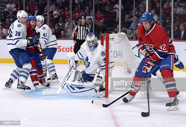 Travis Moen of the Montreal Canadiens looks to pass the puck against the Toronto Maple Leafs during the NHL game on October 1 2013 at the Bell Centre...