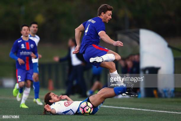 Travis Oughtred of Manly United jumps over Hagi Gligor of Sydney Olympic during the NSW NPL 1 Elimination Final between Manly United FC and Sydney...
